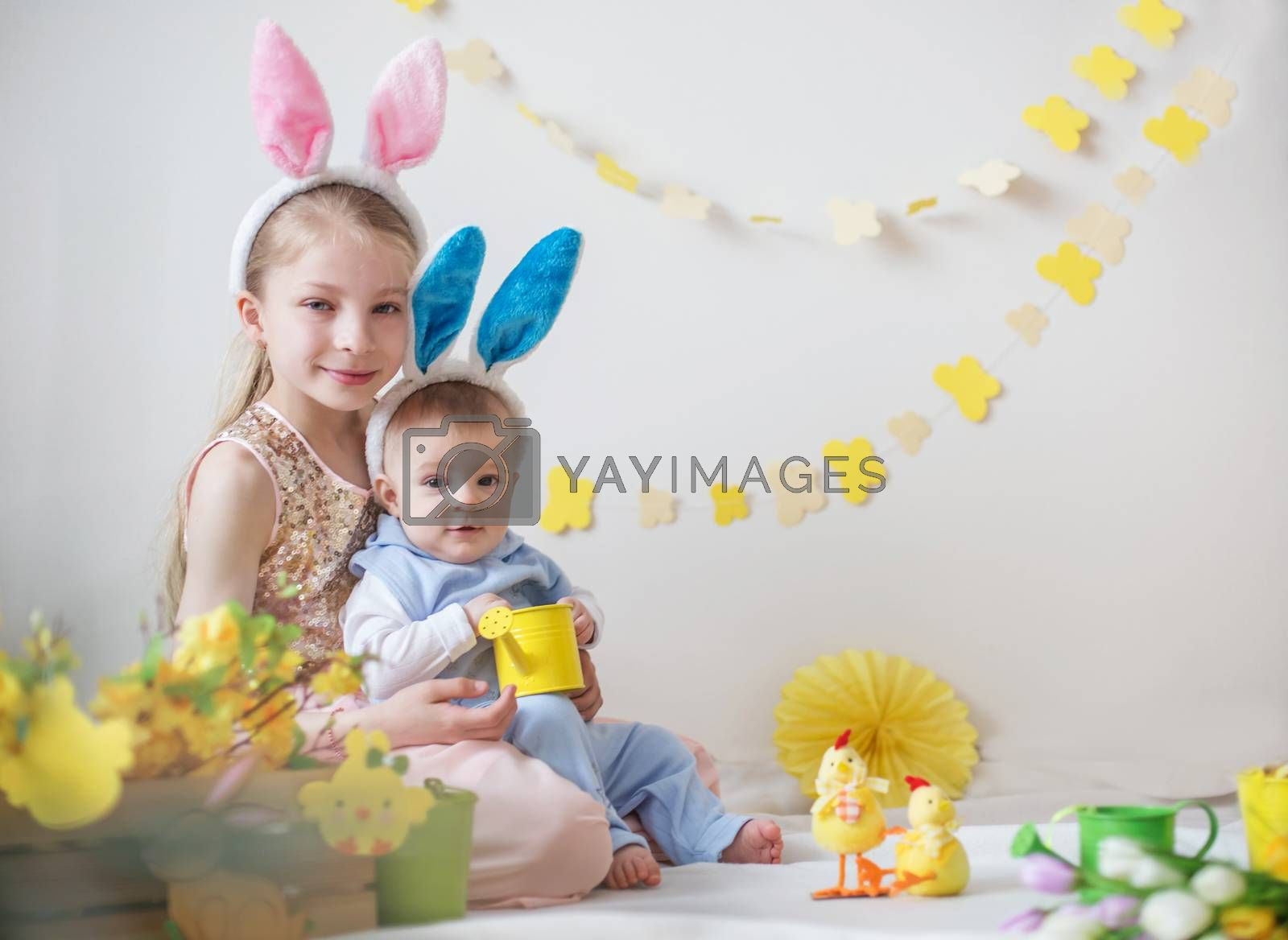 Loving cute girl and her little brother wearing bunny ears