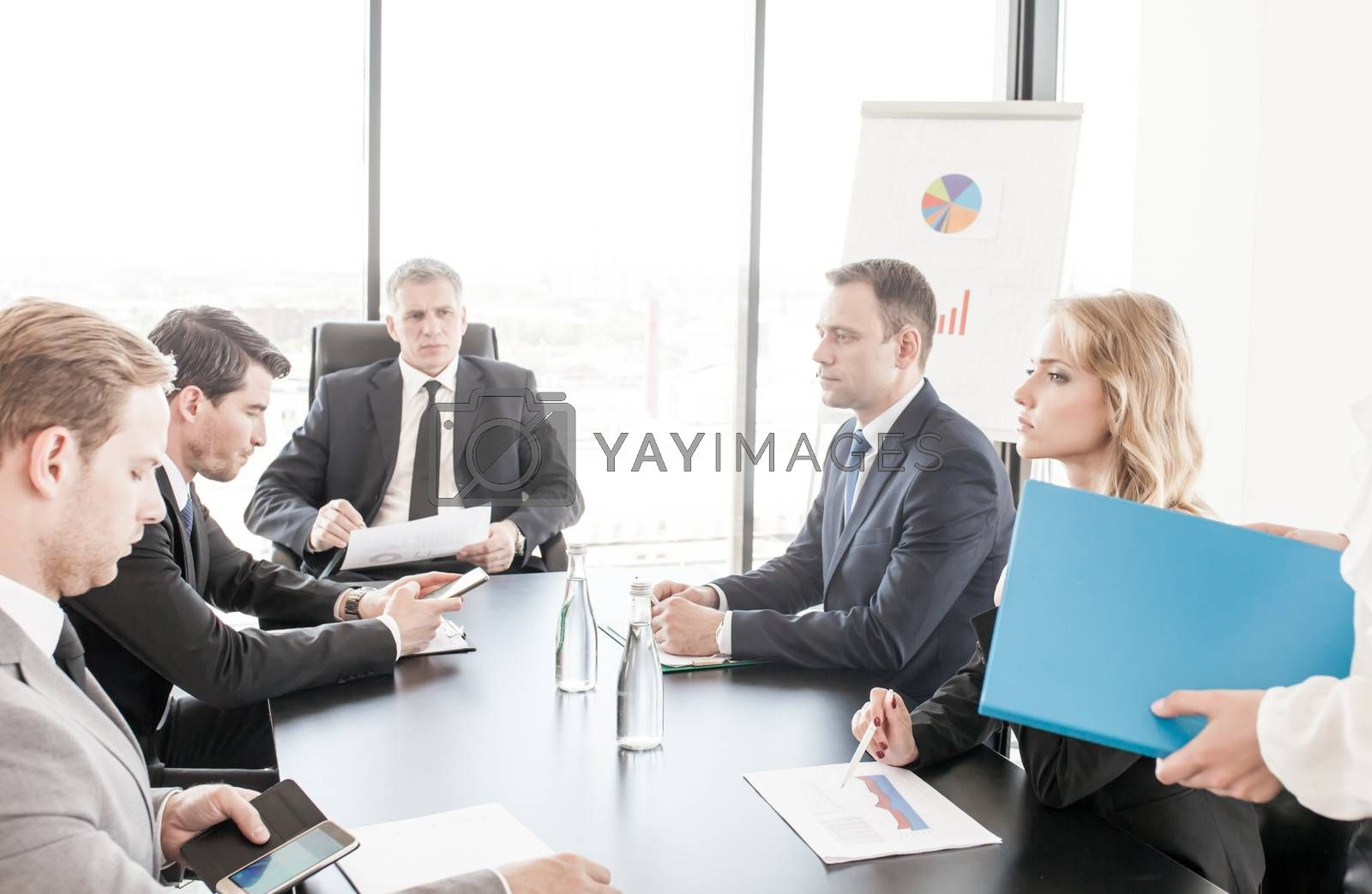 Group of business people discussing with analyzing data financial reports at the office desk