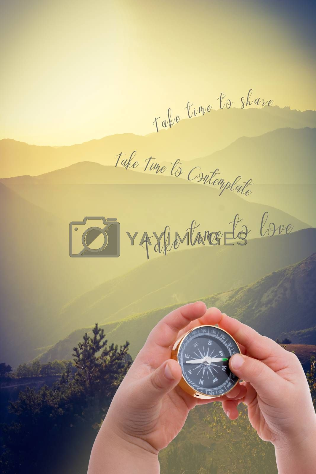 Compass in hand with take time to love on landscape