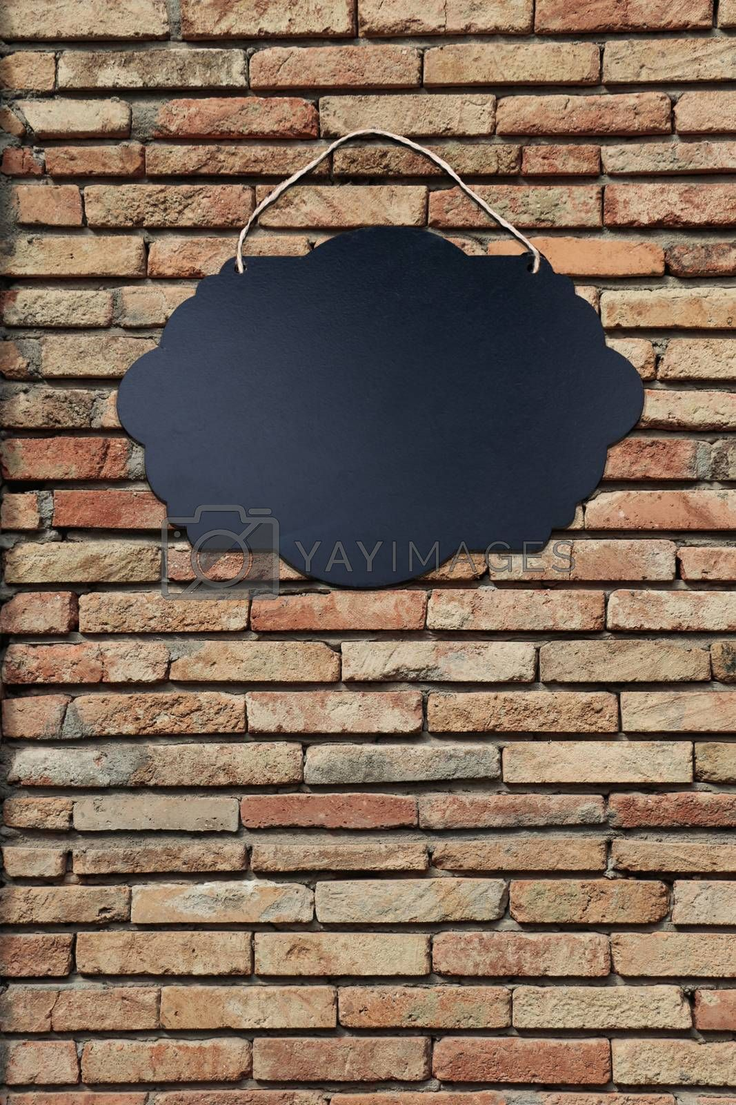 Black Empty Sign Board on brick background by berkay