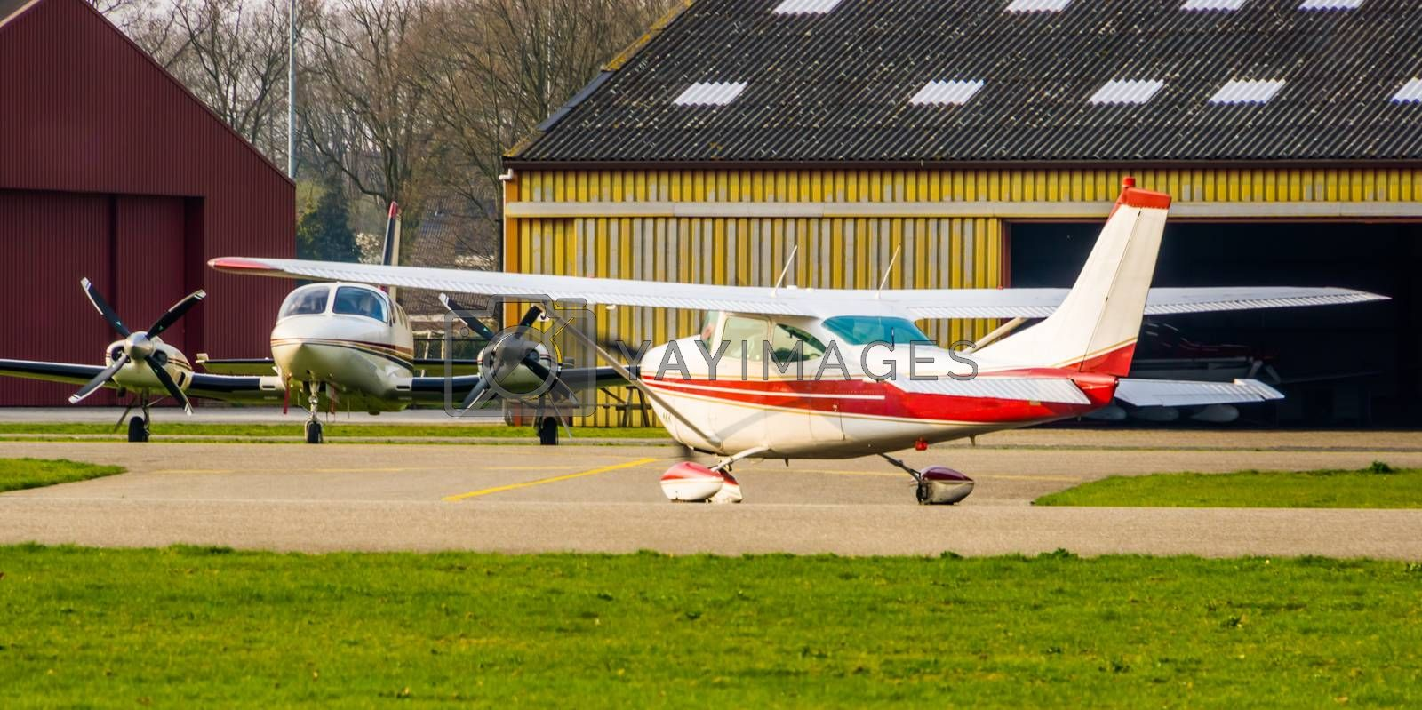 White plane landing and driving to the parking, stunt aircraft, air transportation