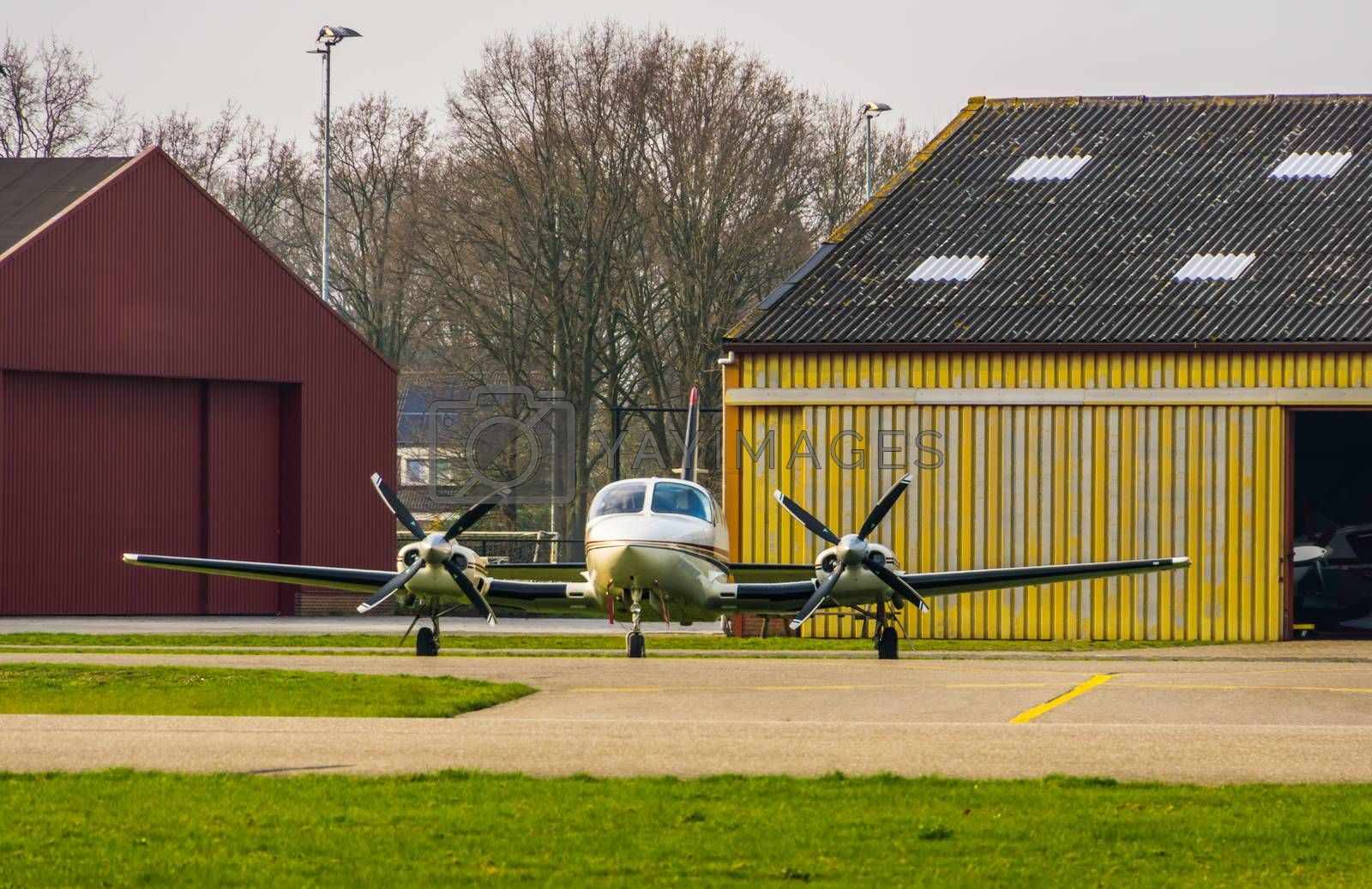 parked air plane at the airport front view, air transportation background