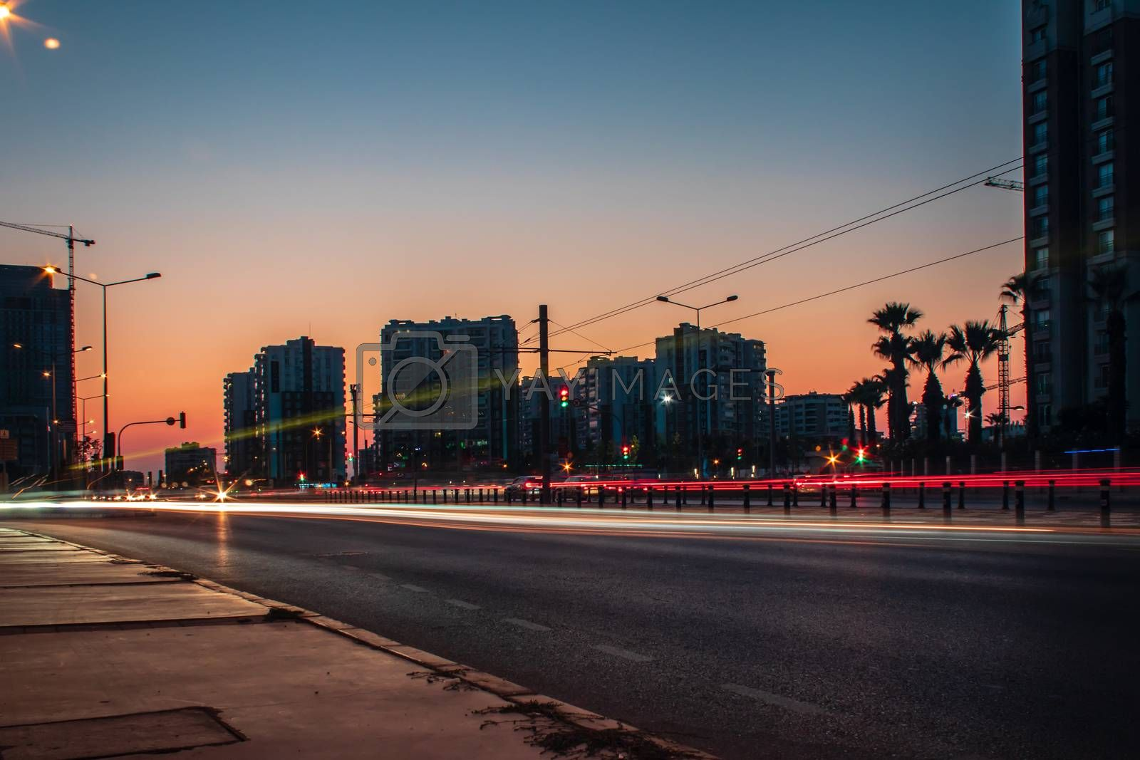 a long exposure cityscape shoot at sunset - orange color is dominant. photo has taken at izmir/turkey.