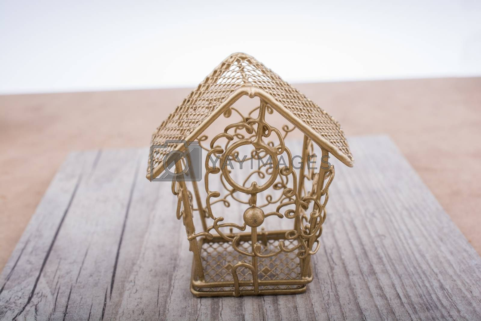 Little white bird house made of metal