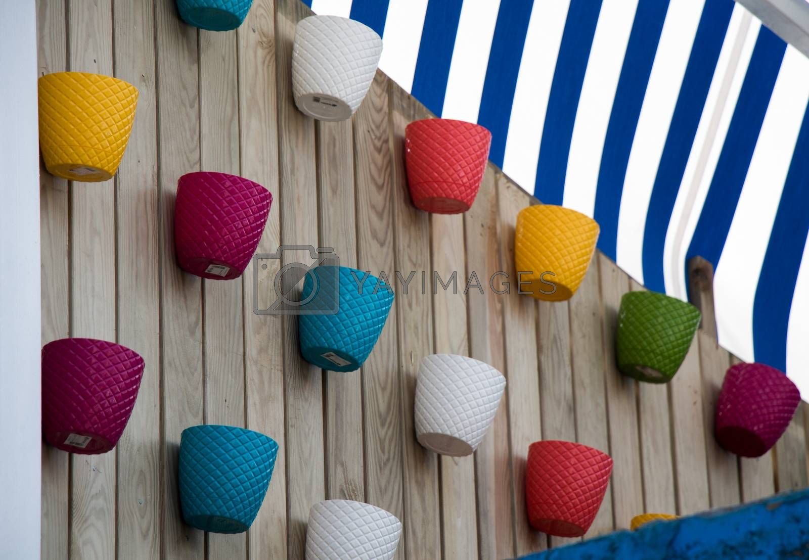 Set of multicolored flower pots as a gardening equipment