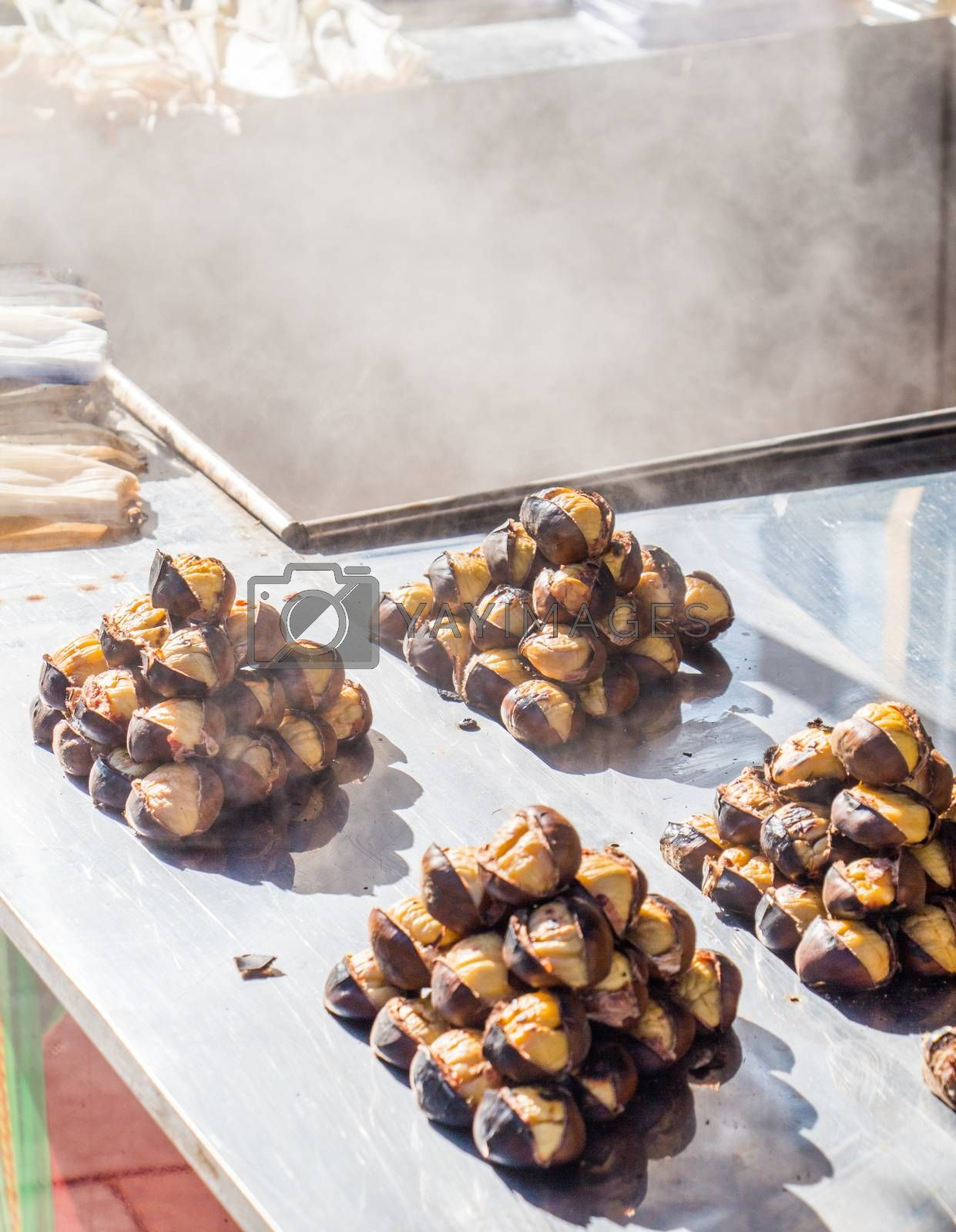 Organic brown chestnuts roasted over a hot fire