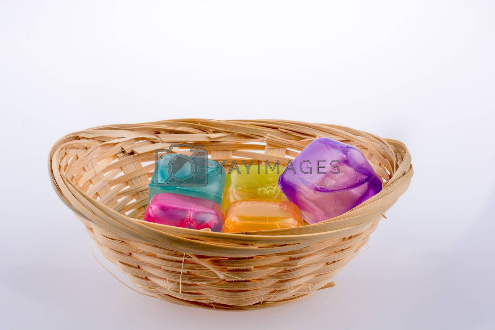 Fake colorful ice cubes on a white background