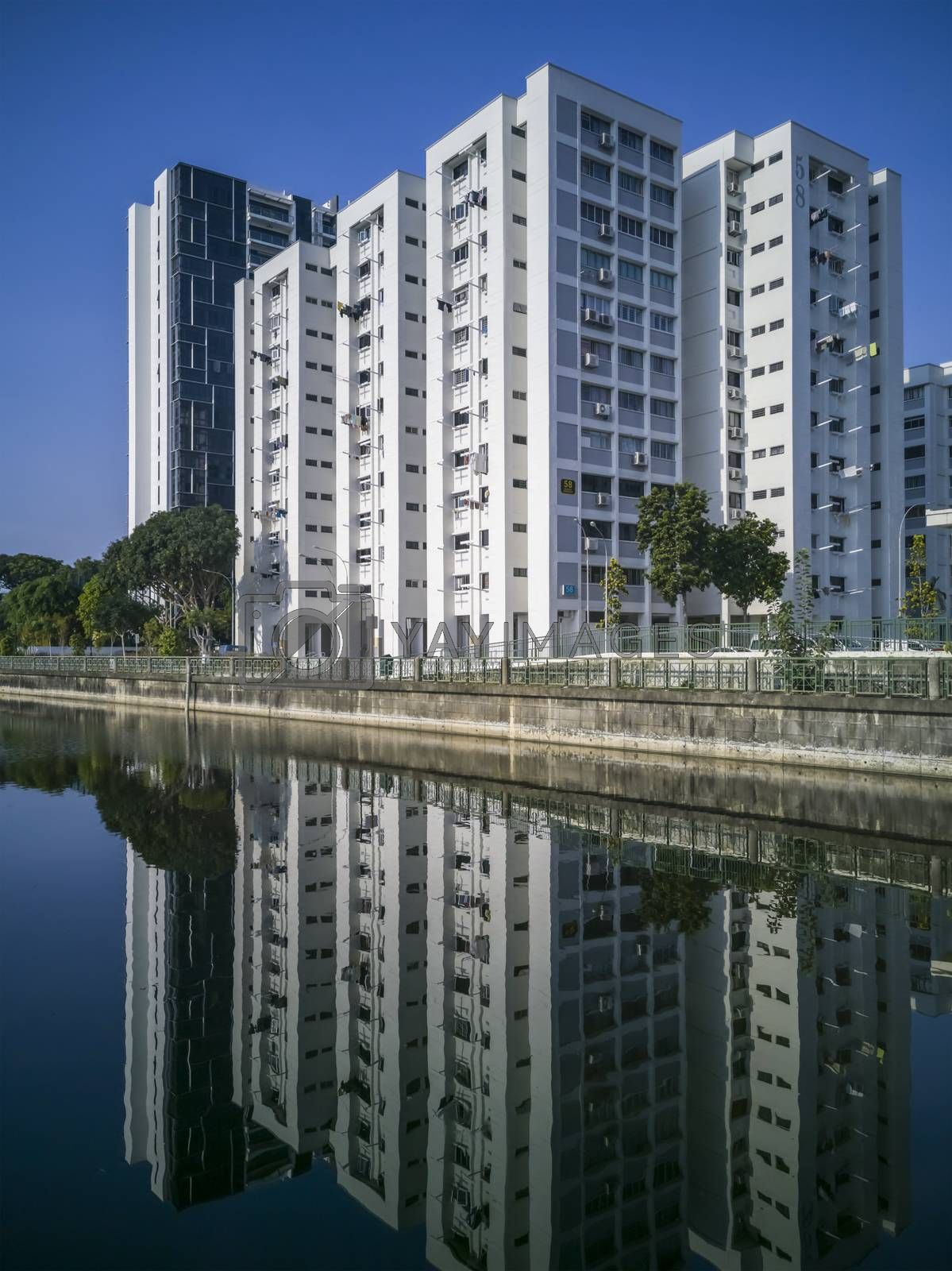 A block of flats with reflections along Geylang River at Geylang Park Connection, Singapore