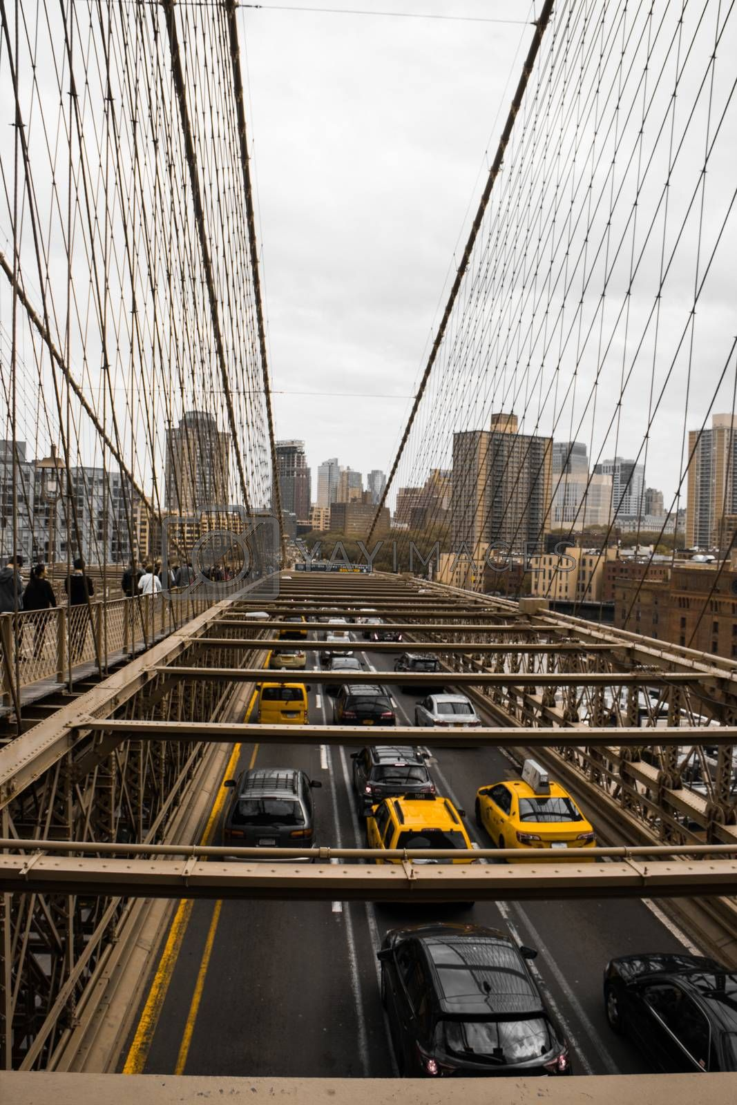 Taxis and cars driving across the brooklyn bridge in new york city during rush hour
