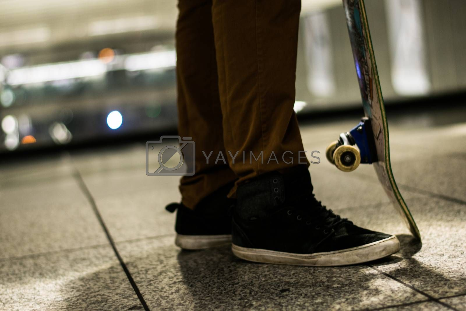 Skateboarder in urban area train station