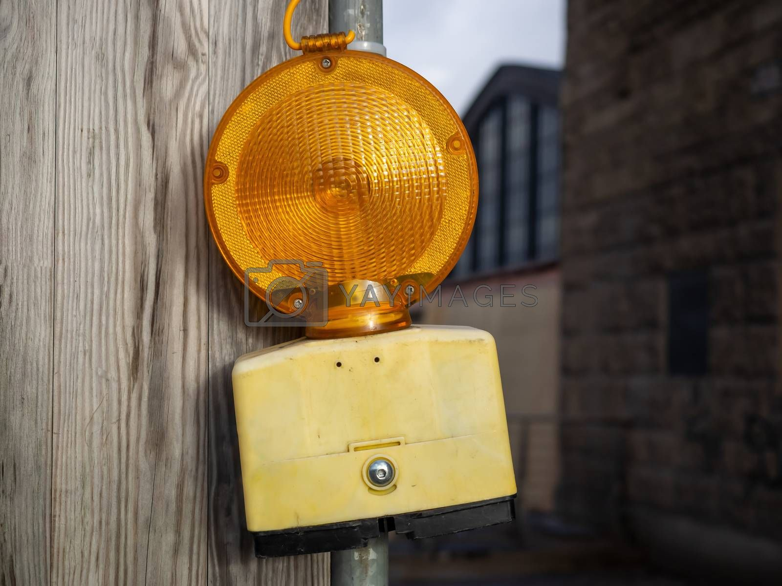 A warning light of a construction site in the city by Sandra Fotodesign