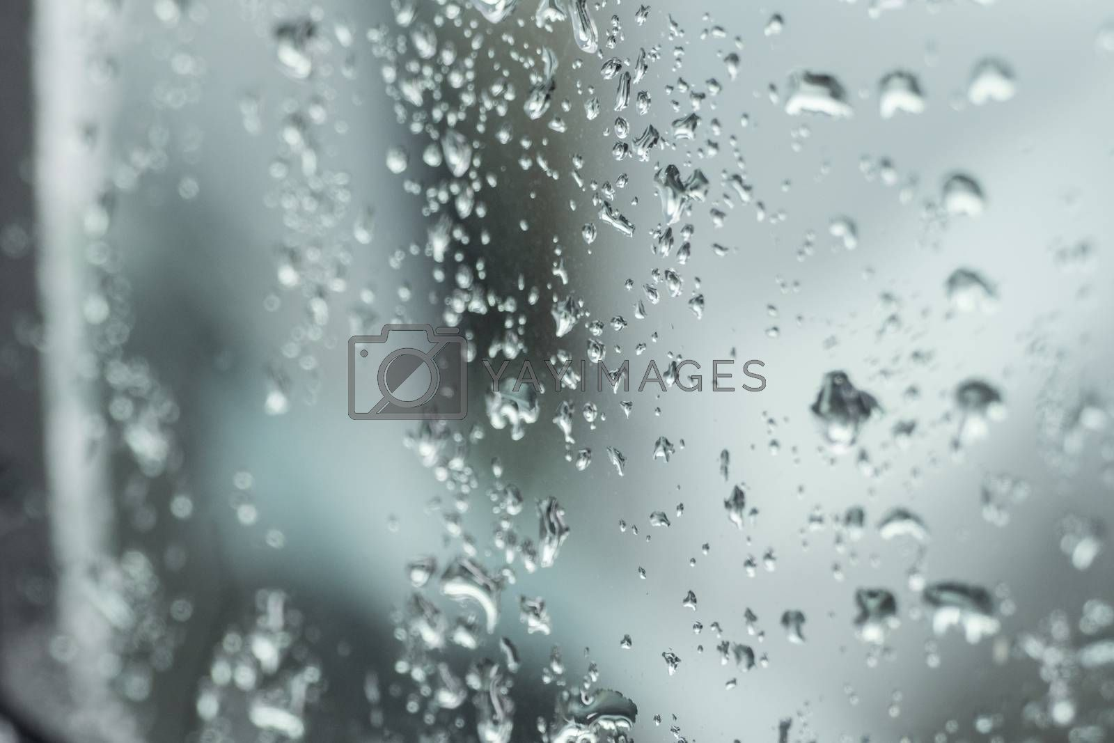 Many small drops of water on the car window by Sandra Fotodesign