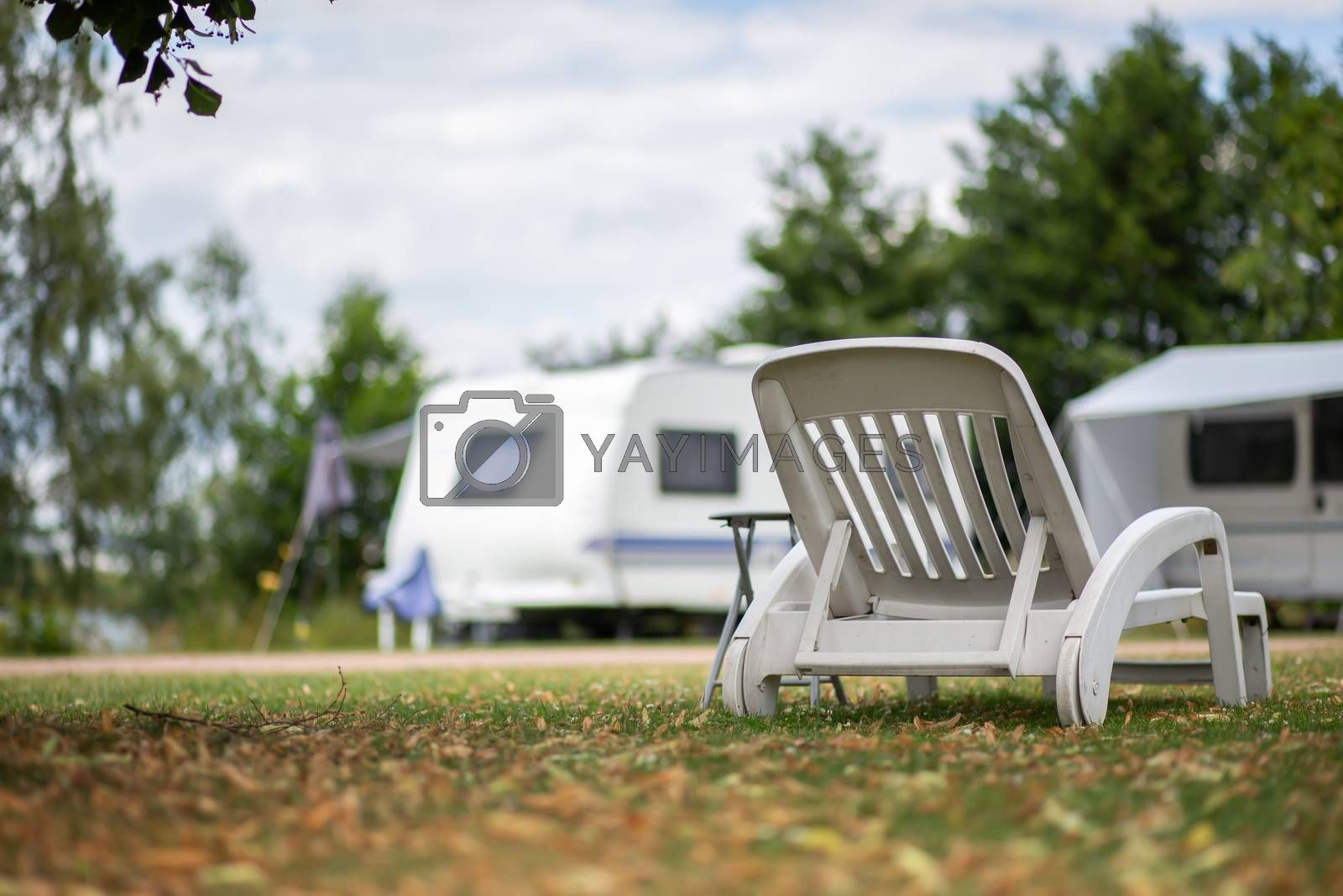 White deckchair in a meadow at a campsite by Sandra Fotodesign