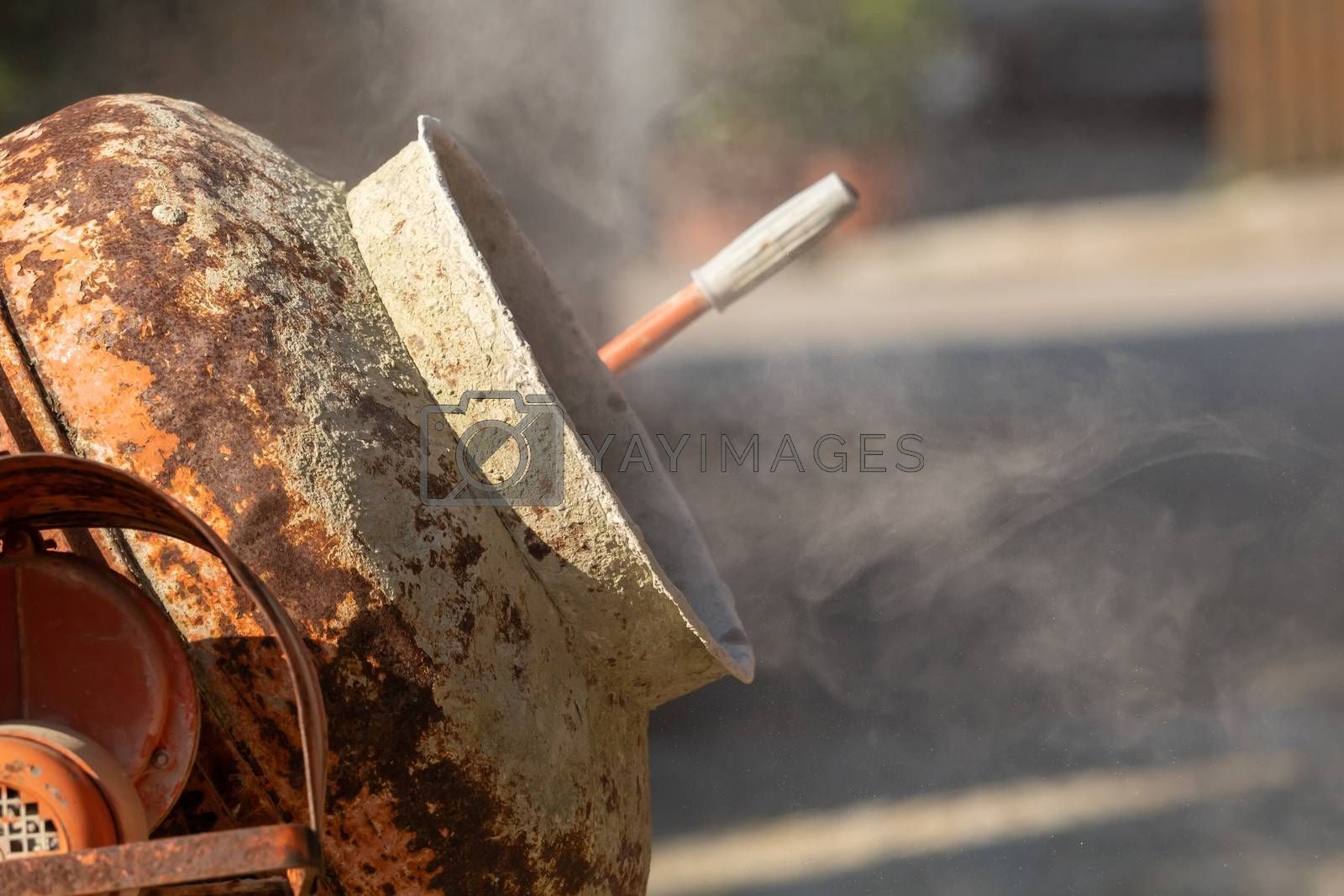 Construction site work with concrete mixer and wheelbarrows by Sandra Fotodesign