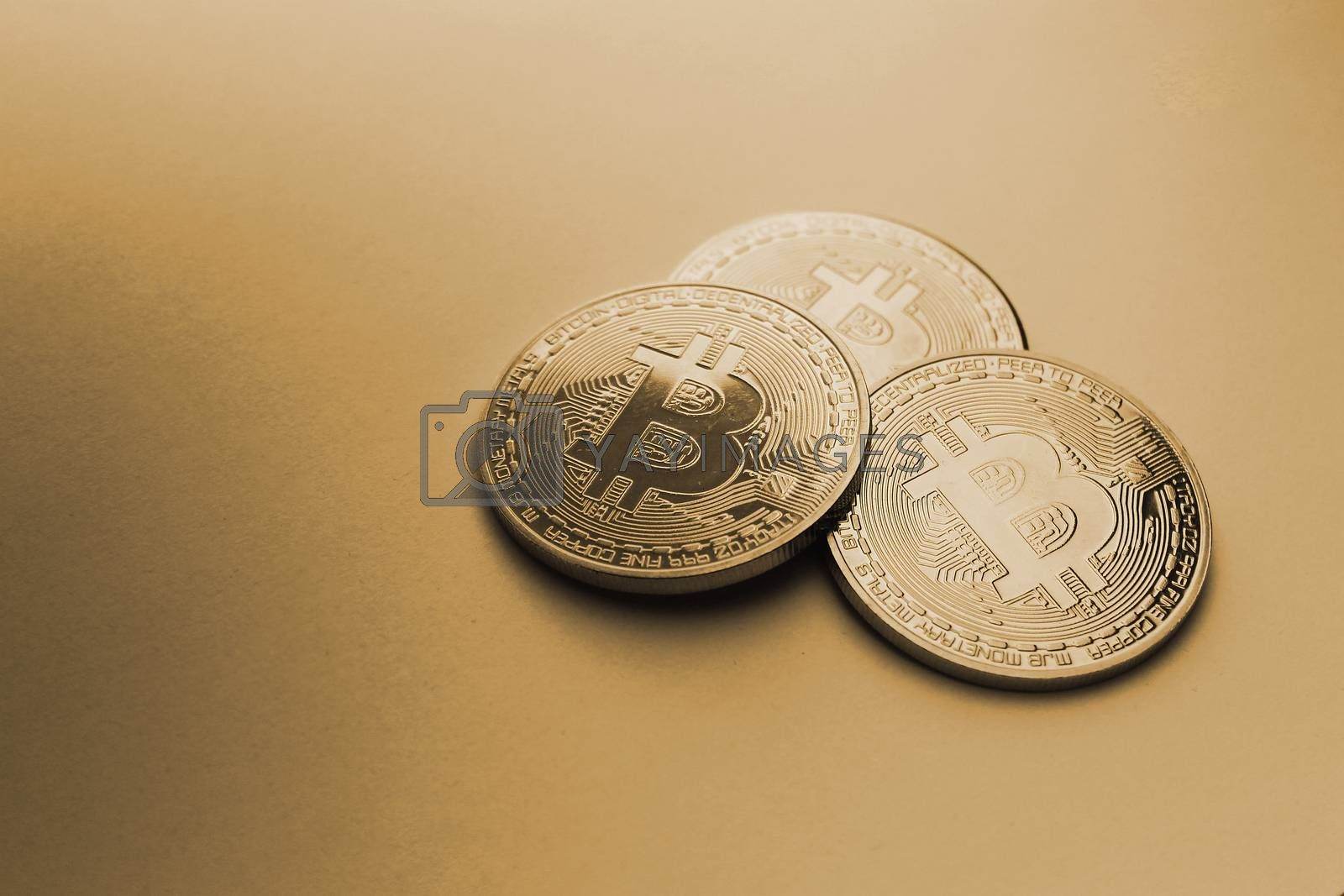 natural gold bitcoin on gold background paper by jordano