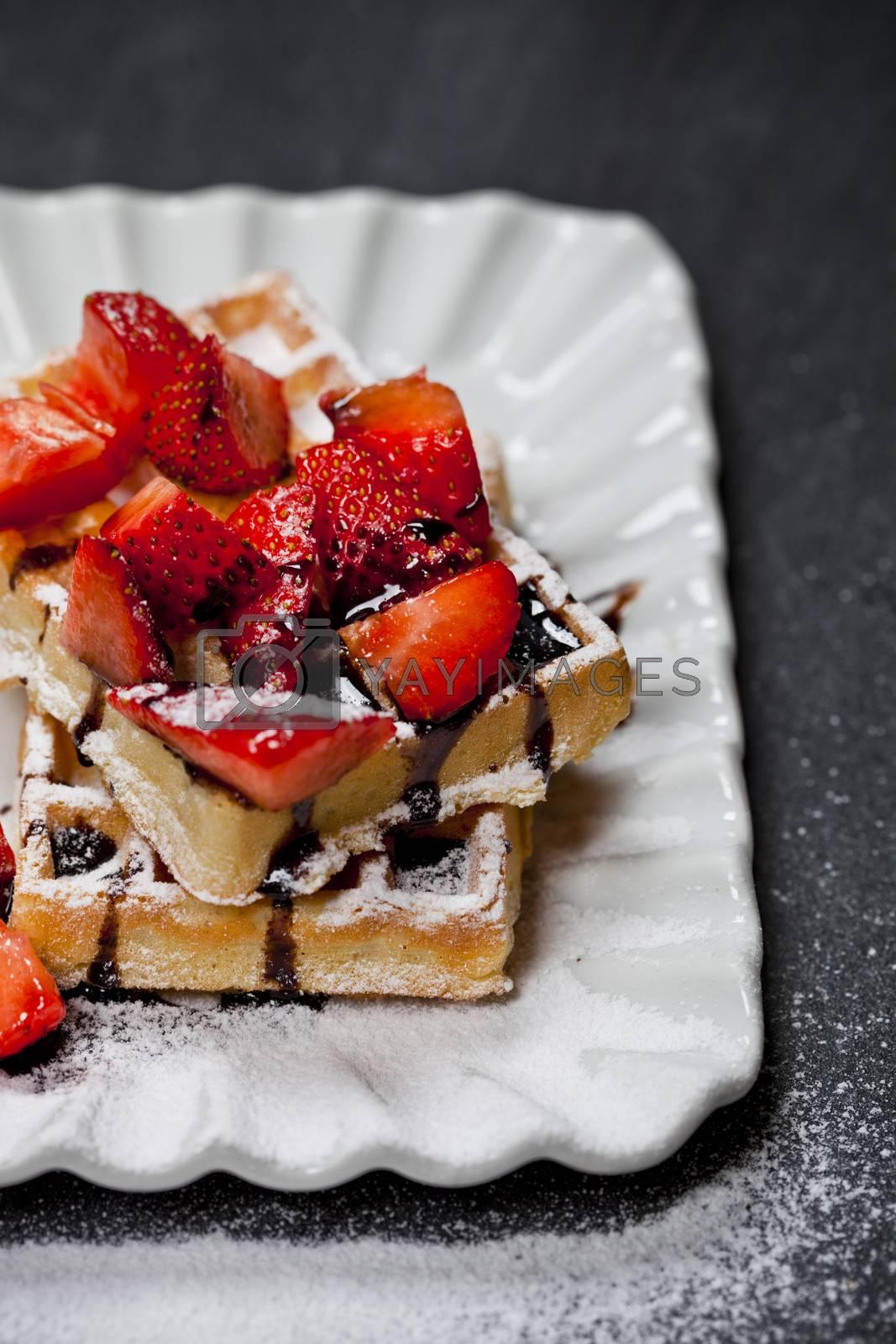 Belgium waffers with sugar powder, strawberries and chocolate on by marylooo