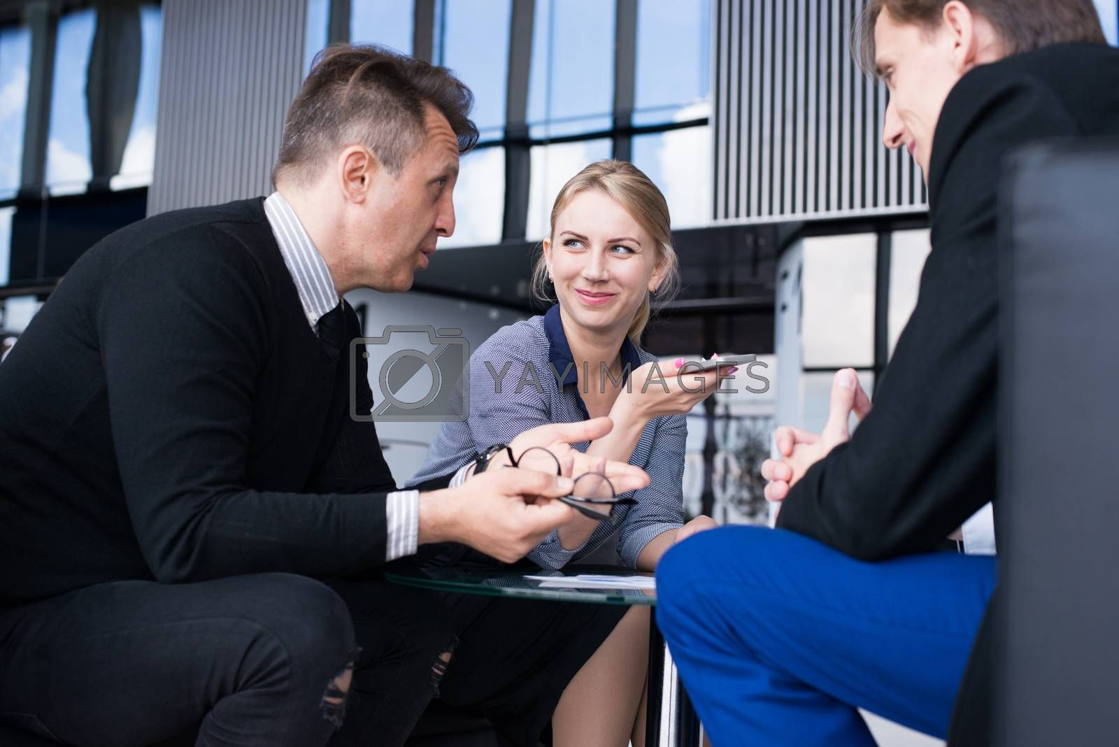 Business people talking in cafe by ALotOfPeople