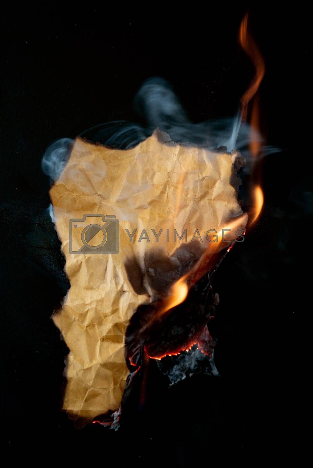 burning piece of crumpled paper by anankkml