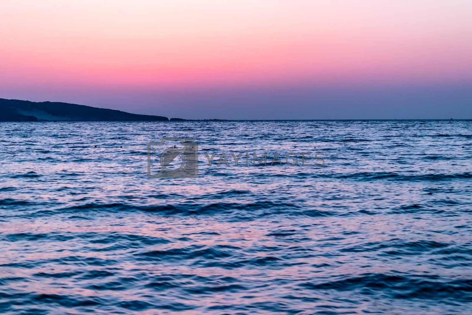 a wide landscape shoot of sea at sunset with awesome colors by Swonie