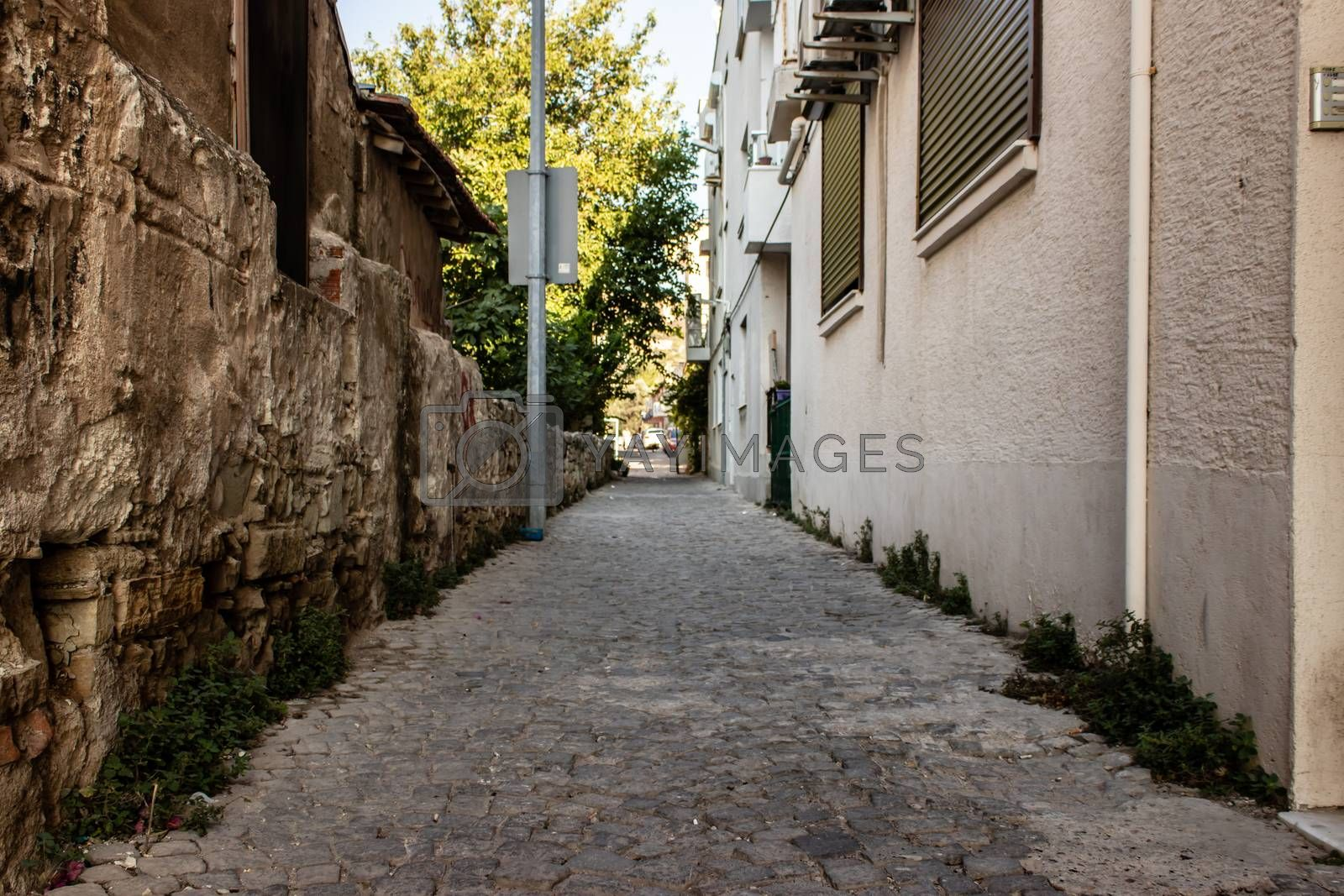 a wide shoot of urban street with stone floors and old vintage b by Swonie