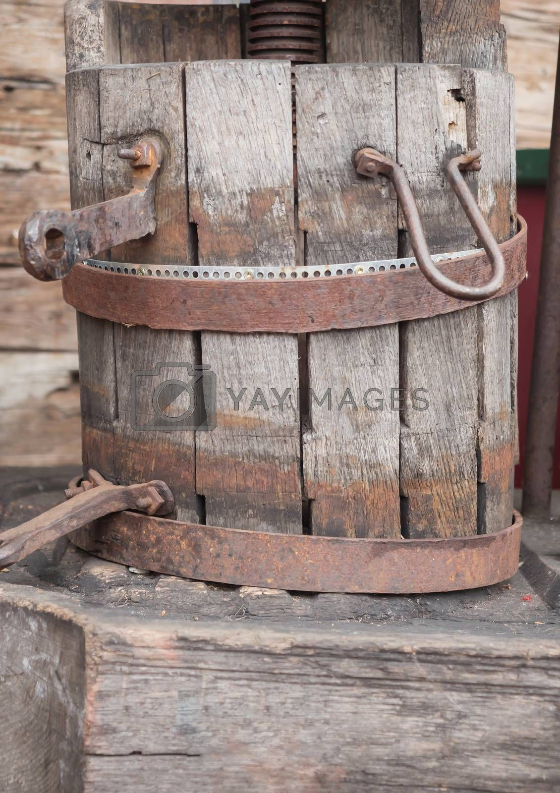 A historic wooden bucket with an iron ring by Sandra Fotodesign