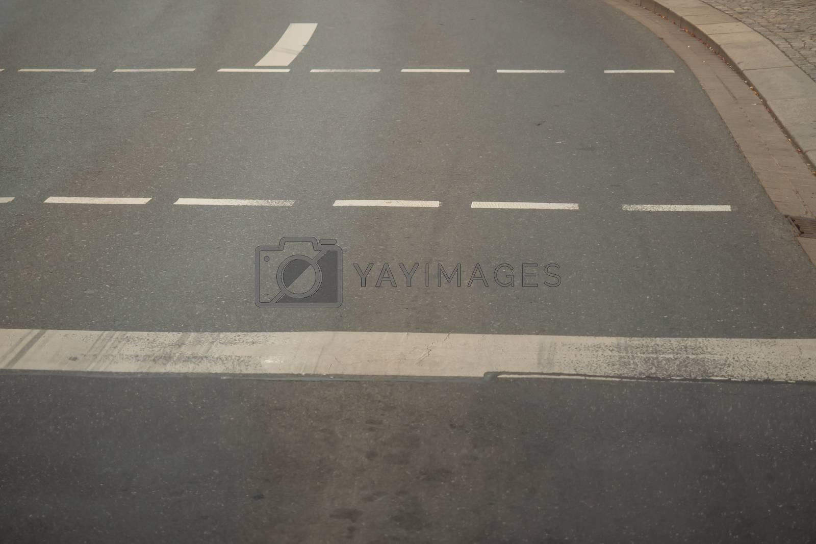 Gray asphalt road with white stripes by Sandra Fotodesign