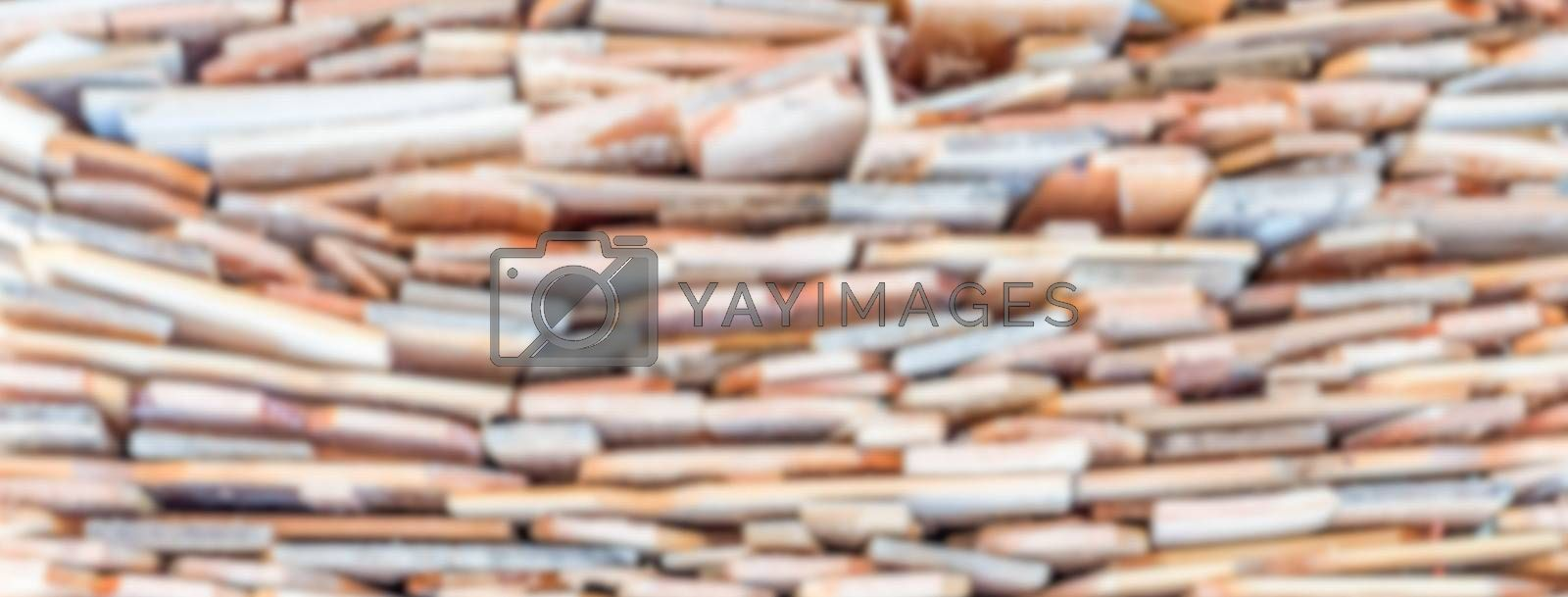Defocused background with stack of wood. Intentionally blurred post production for bokeh effect