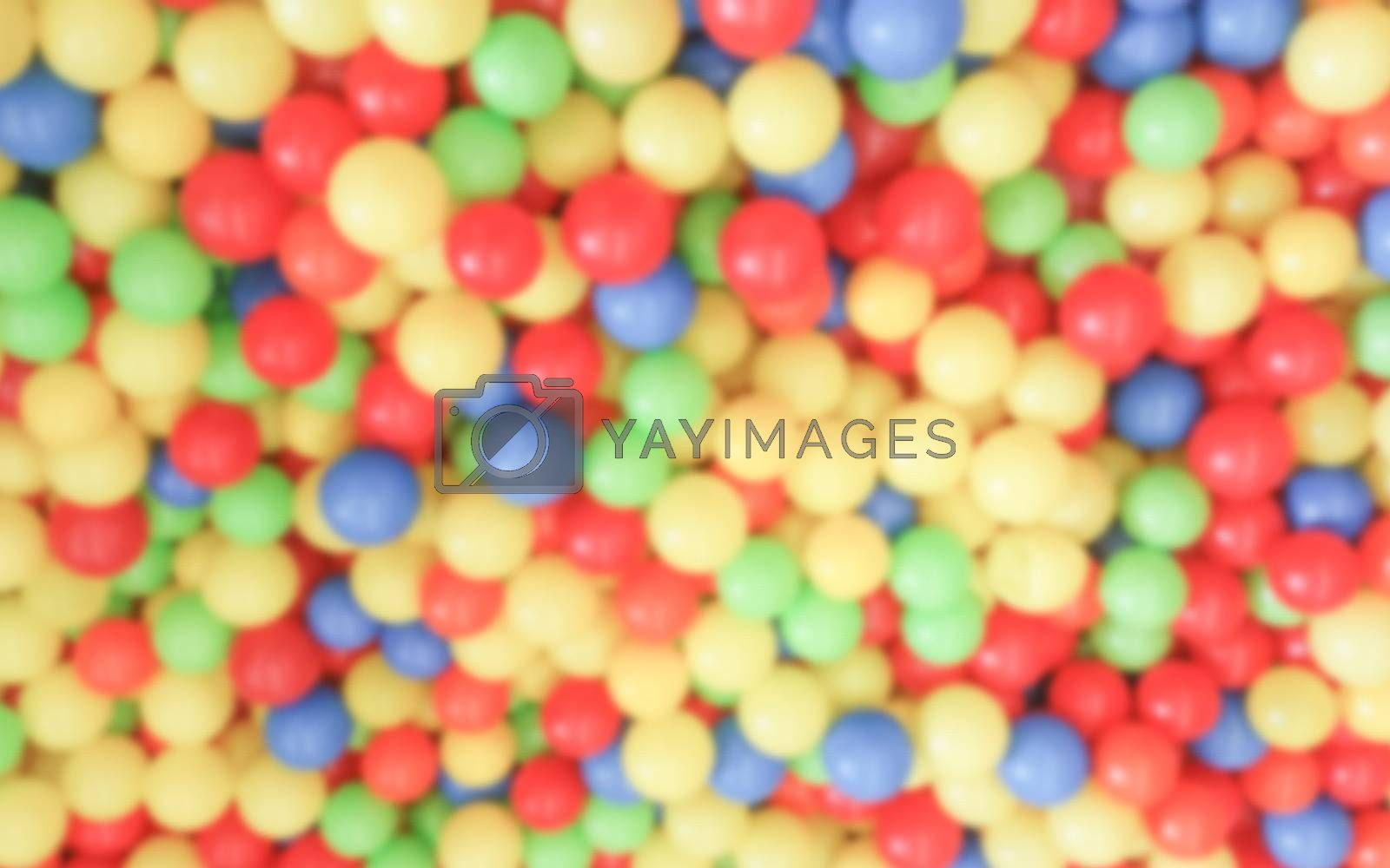 Defocused background with colorful plastic balls in children's playground pool. Intentionally blurred post production for bokeh effect