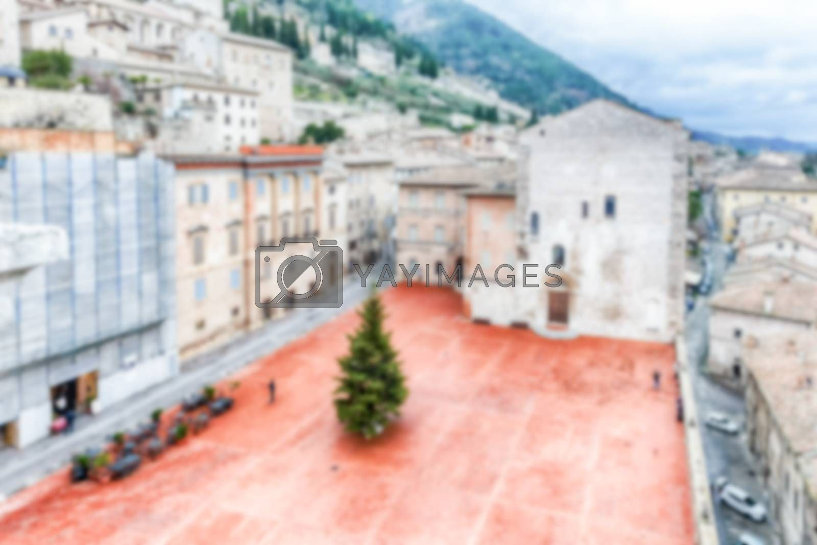 Defocused background of Piazza Grande, scenic main square in Gubbio, Italy. Intentionally blurred for bokeh effect