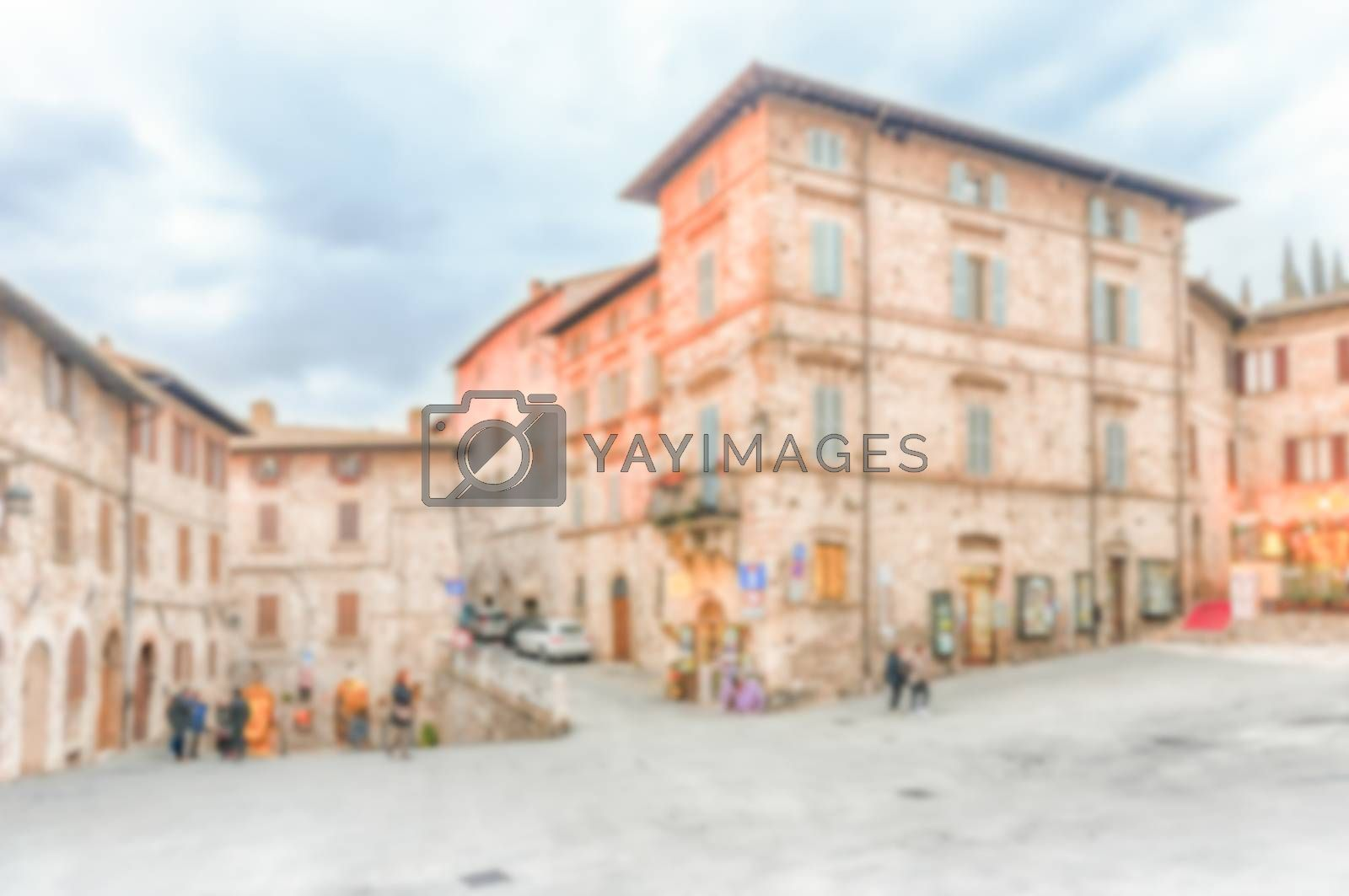 Defocused background of the picturesque and ancient streets of Assisi, one of the most beautiful medieval towns in central Italy. Intentionally blurred post production for bokeh effect