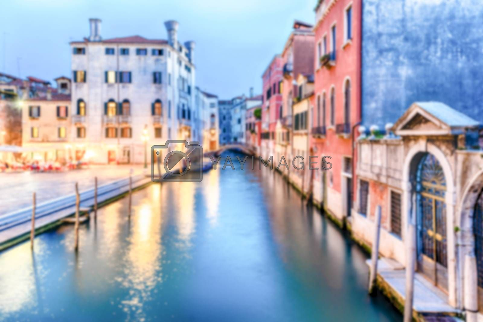 Defocused background of picturesque canal with beautiful reflections in Castello district of Venice, Italy. Intentionally blurred post production for bokeh effect