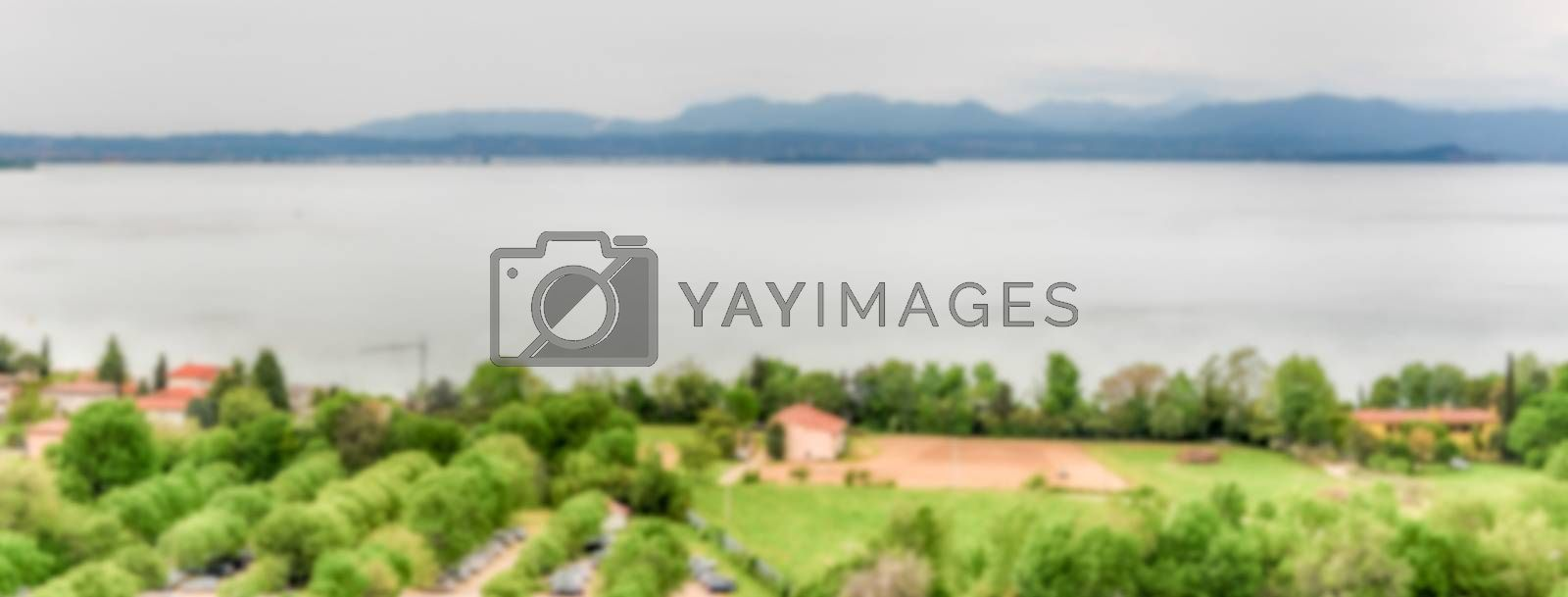 Defocused background with aerial view of Lake Garda, Italy. Intentionally blurred post production for bokeh effect