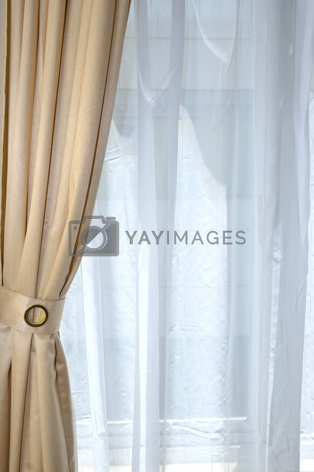 gold curtain on the window with white layer