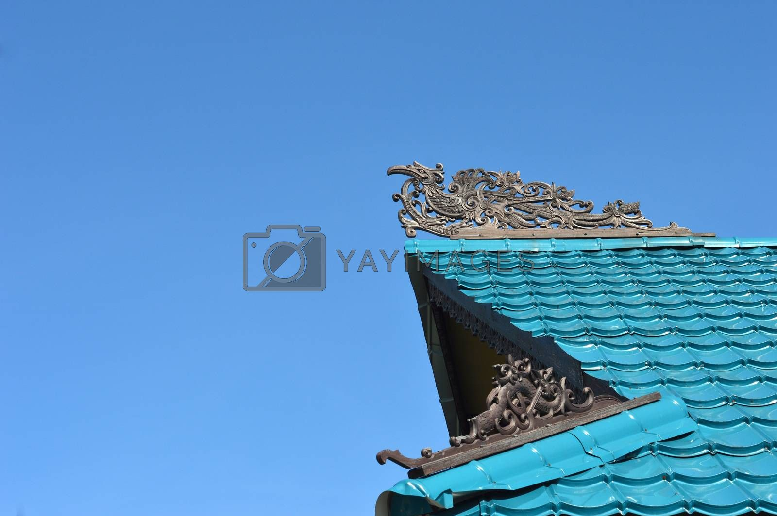 Dayak ornaments on the traditional tribal carvings at the roof top of buildings