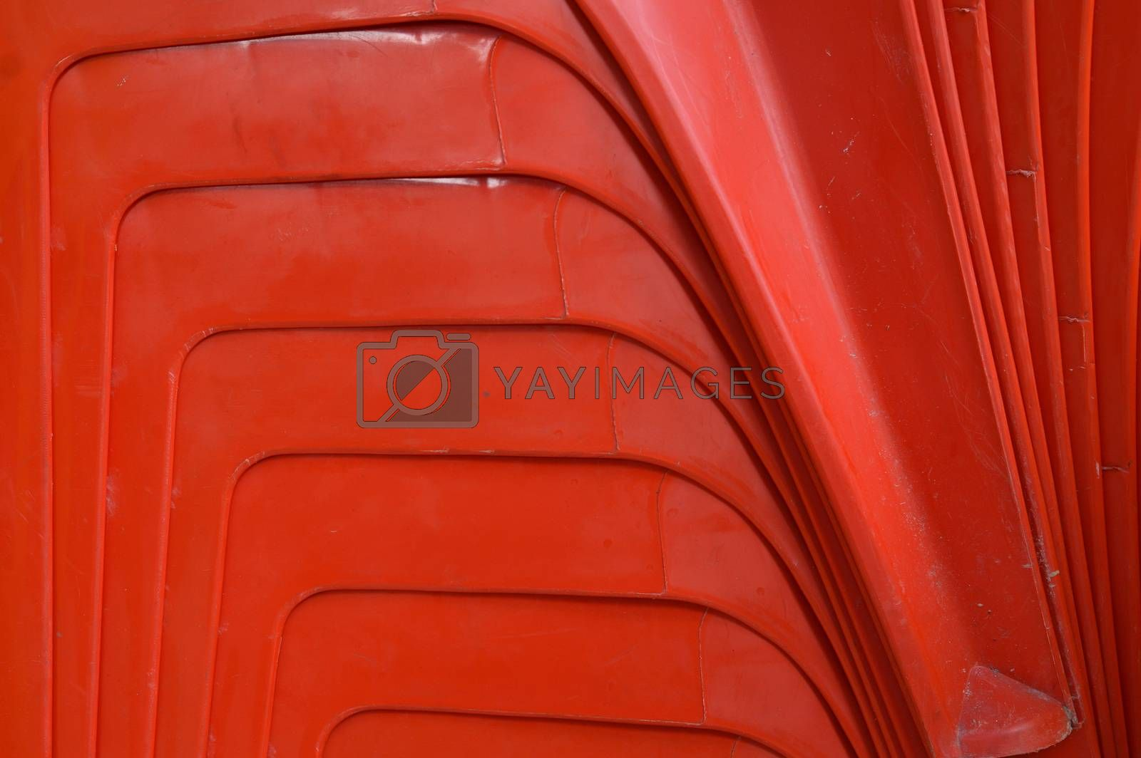color abstract on the  red stacks of plastic chairs
