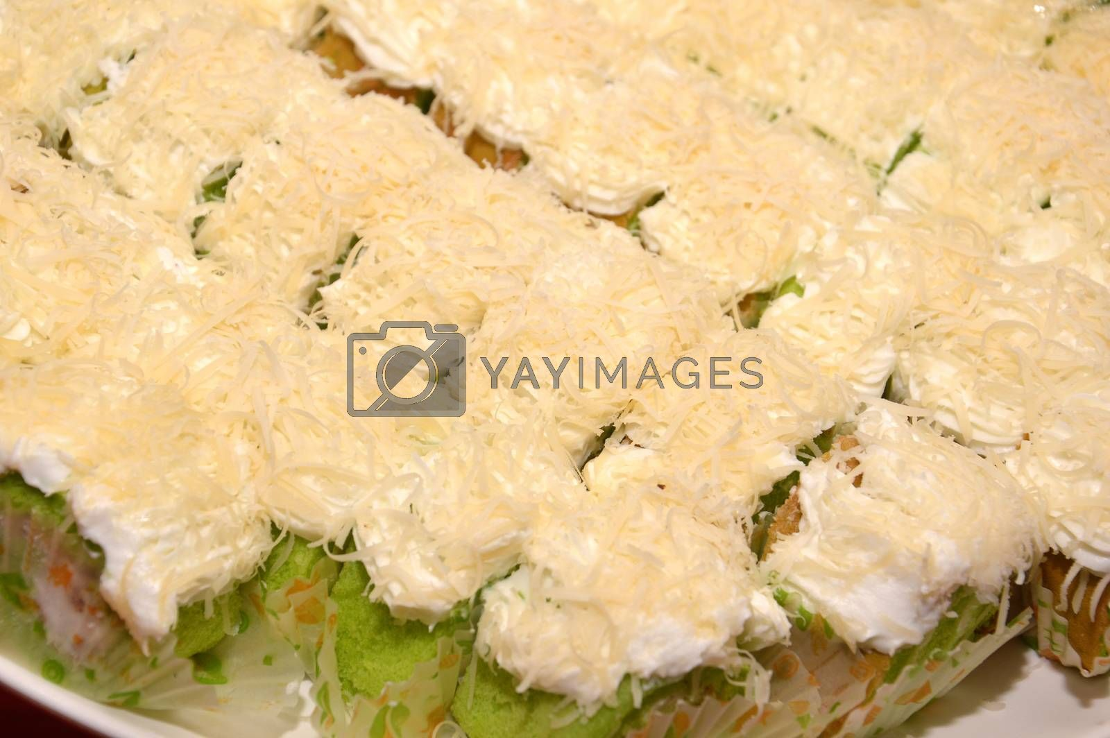 sponge cake with grated cheese on white plate