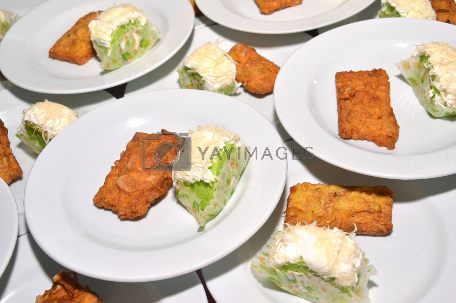 tempe and sponge cake on  white plate