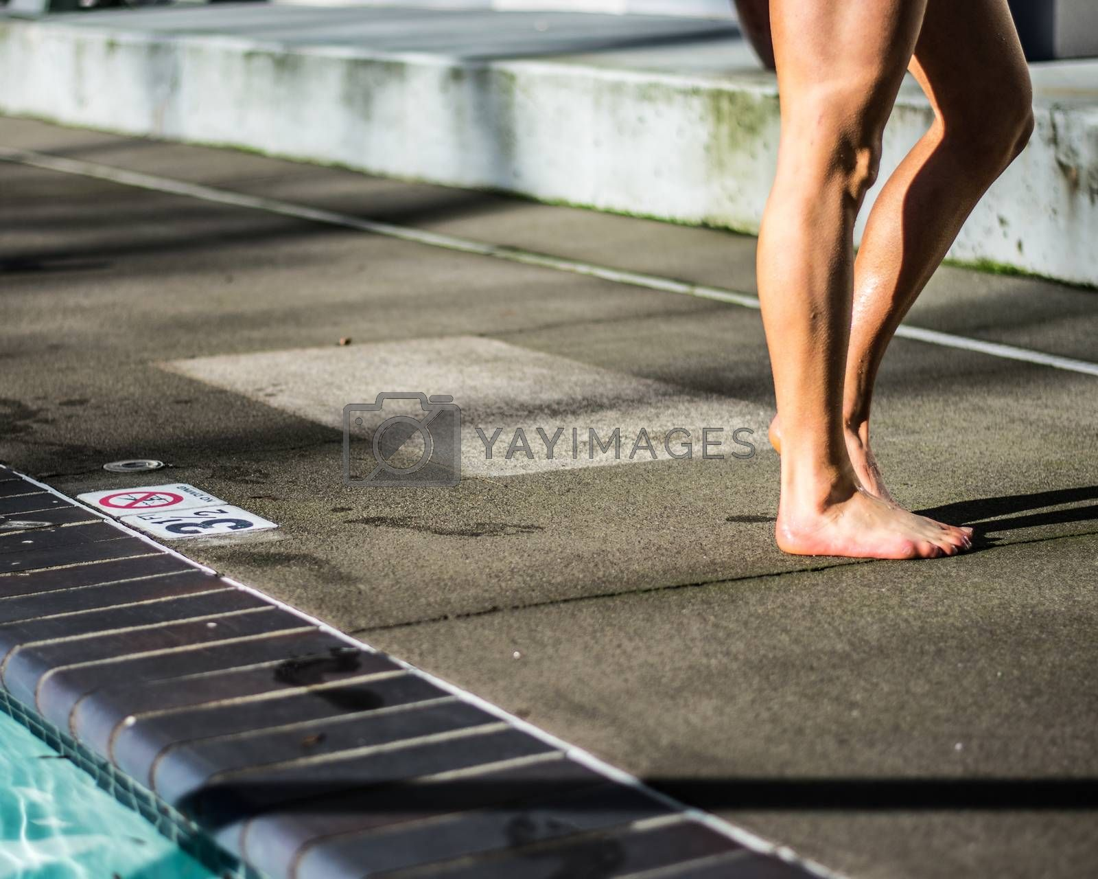 Girl drying next to pool on sunny summer day