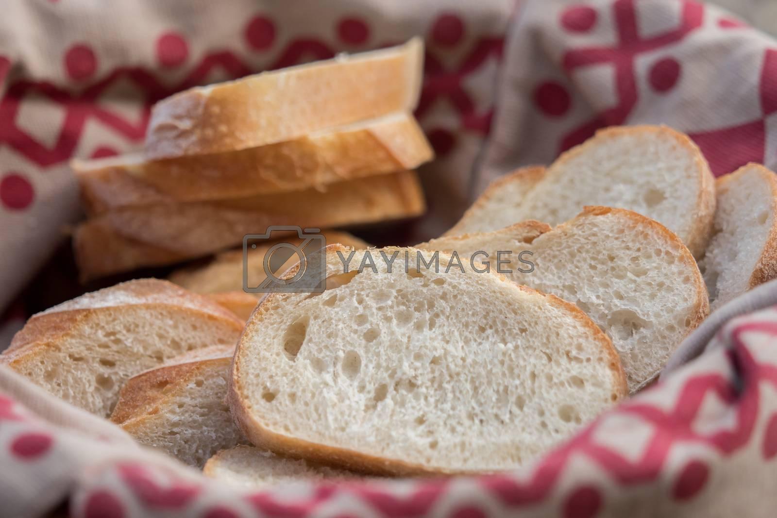 Fresh white bread cut in bread basket by Sandra Fotodesign