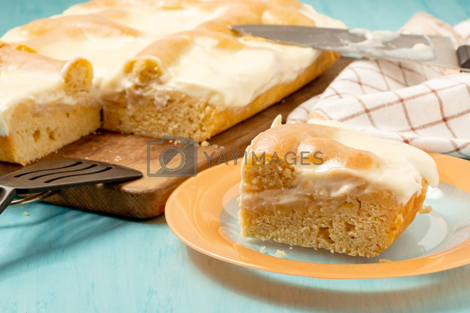 Sliced piece of apple pie with sour cream on a plate - photo, image by galsand