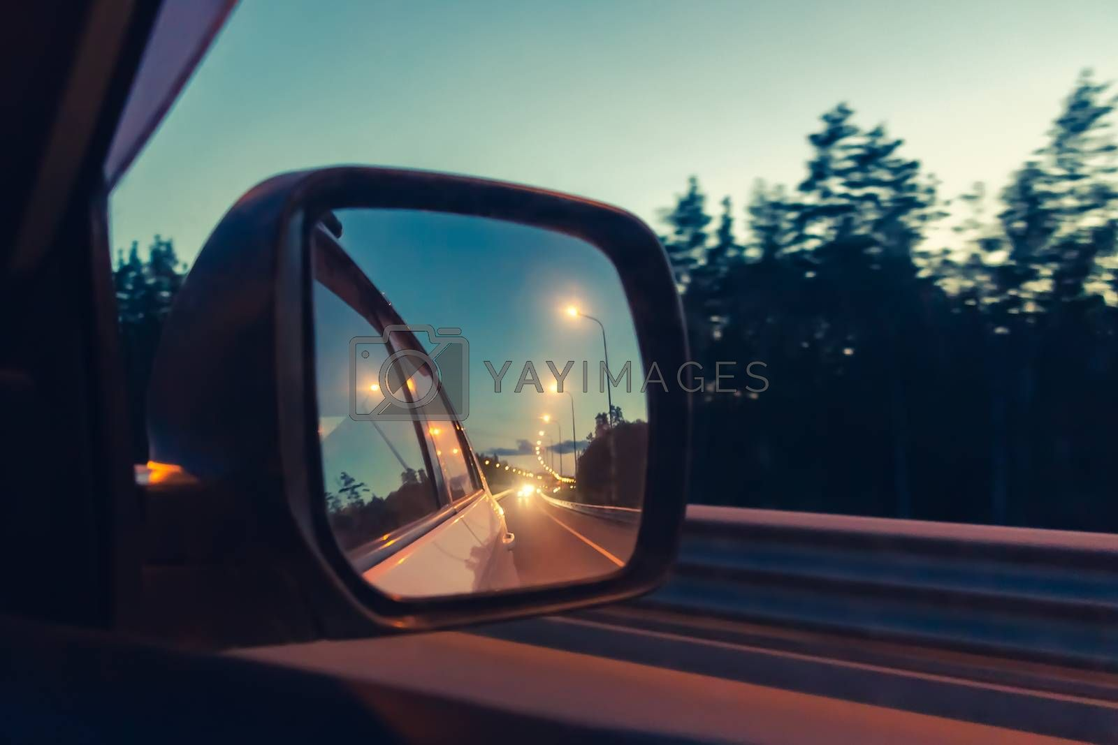 Night highway in the side mirror while driving - photo, image. Soft focus by galsand
