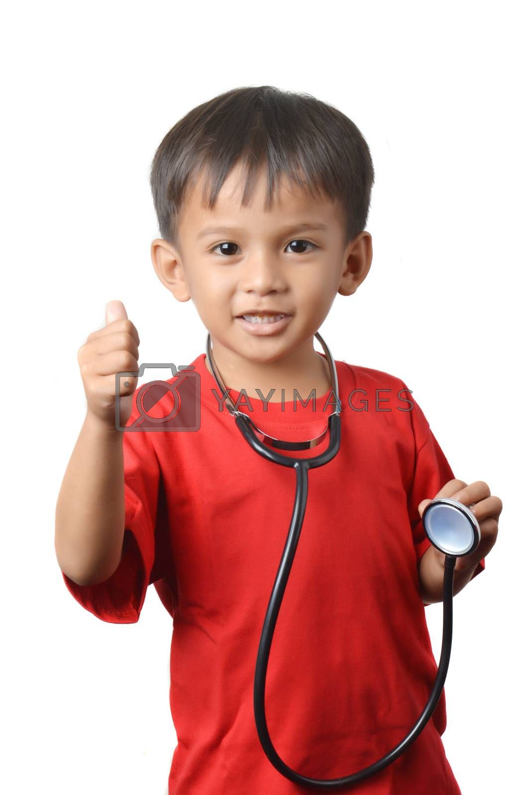 asian little boy holding a stethoscope by antonihalim