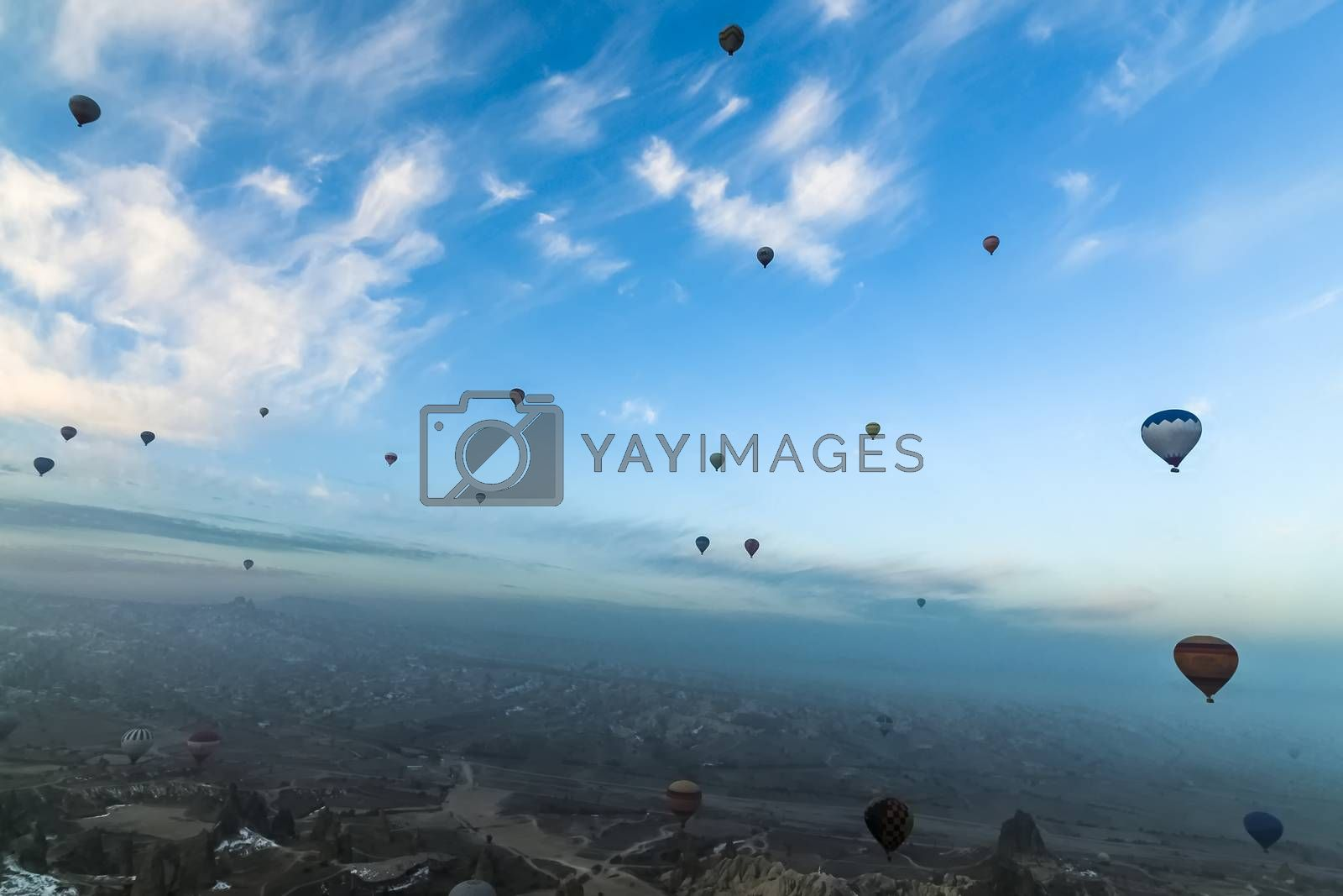 Panorama view of hot air balloons flying over Cappadocia by juliachan