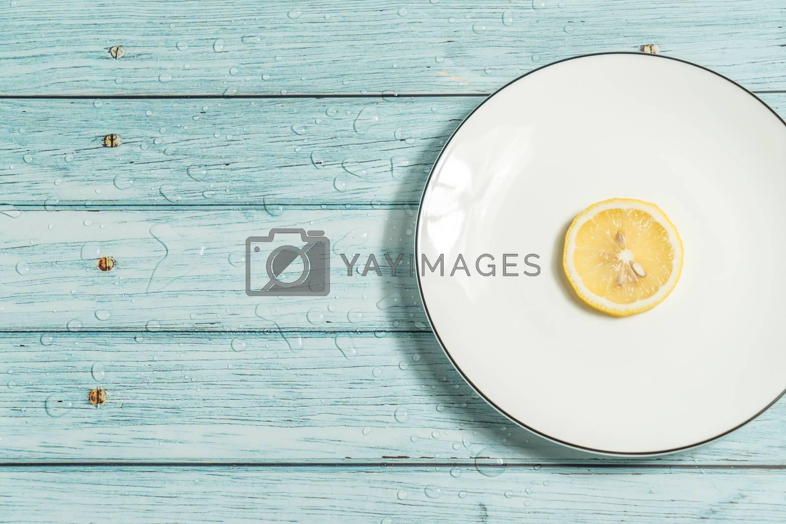 the fruit lemon on the blue table, cool light background by vinkfan