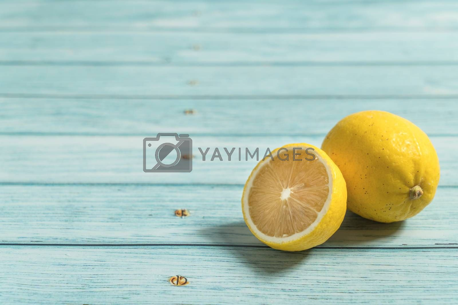 the fruit lemon on the blue table, cool light background by vinkfan