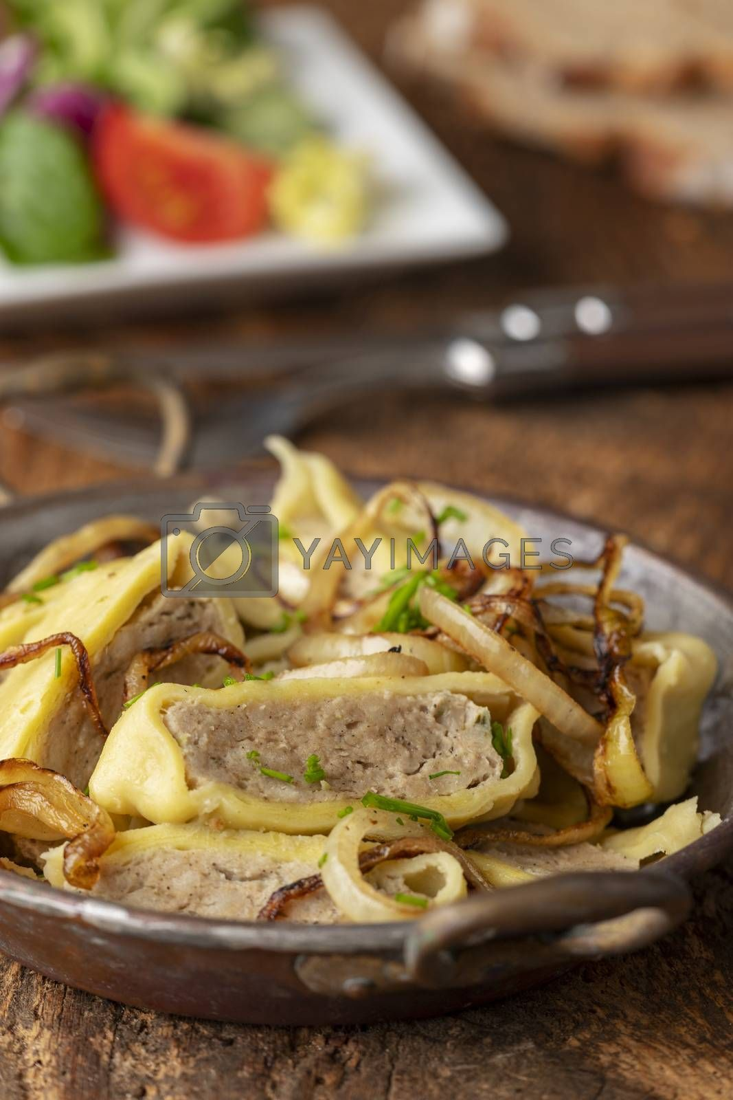 swabian maultasche with onions in a pan  by bernjuer