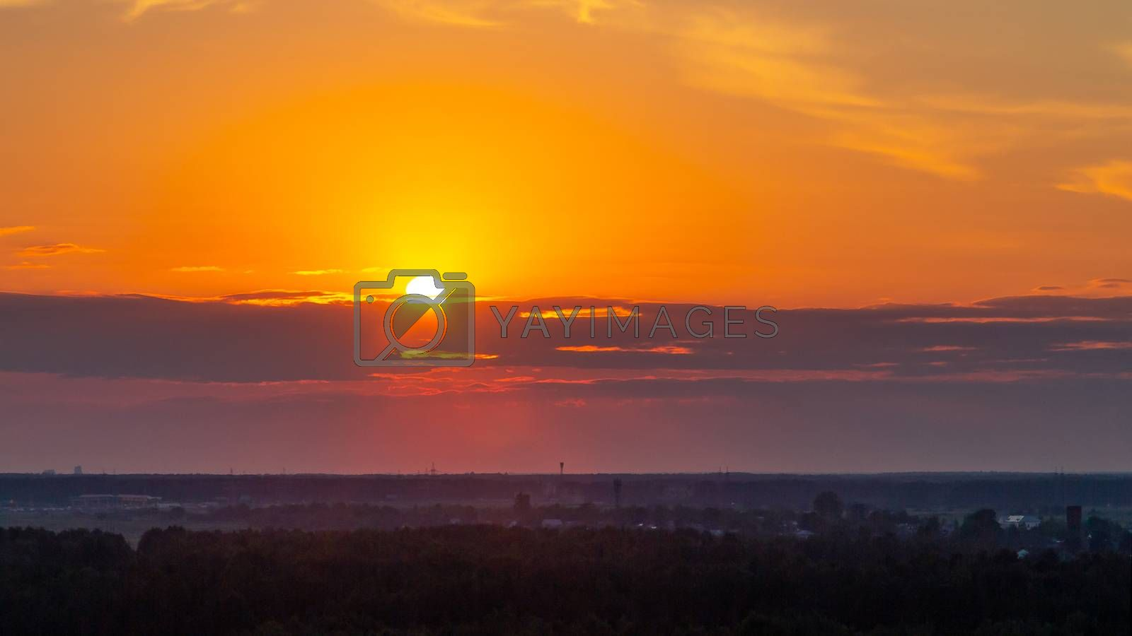 Panoramic view of the horizon and colorful sunset on the outskirts of the city by galsand