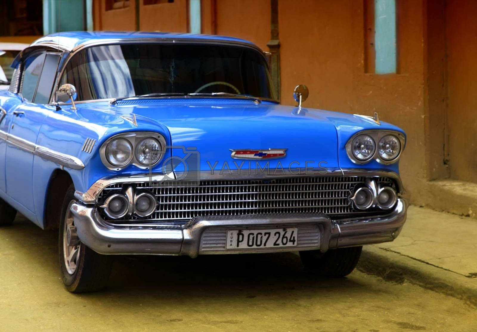 Havana, Cuba - January 11, 2019: Vintage cars moving on the streets of colorful Havana. A great variety of old cars exist In Cuba. On the streets cars from the first half of the 20th century can be found in magnificent conditions, which takes back in history and make the old atmosphere of the cities.