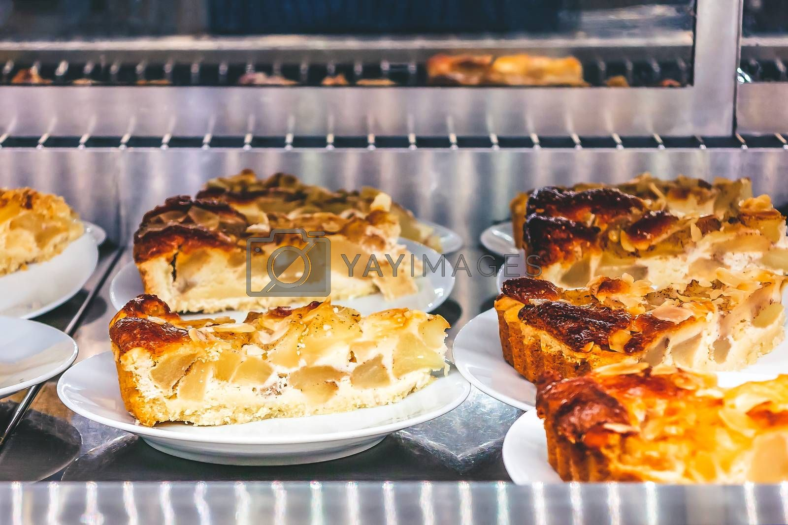 Slices of apple pie lined for sale in a cafe by galsand