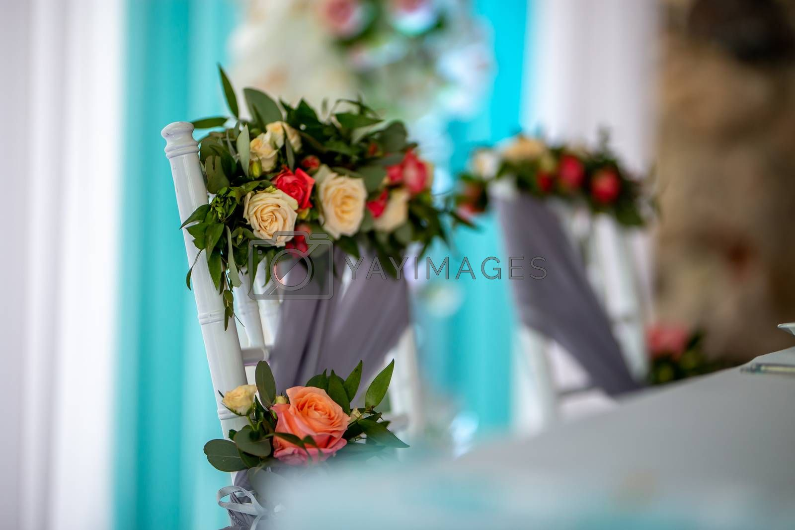 Bouquet of roses tied on the chair  by fotorobs